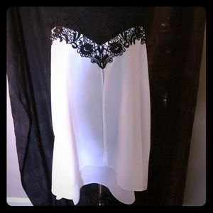 White and black trimmed dressy tank
